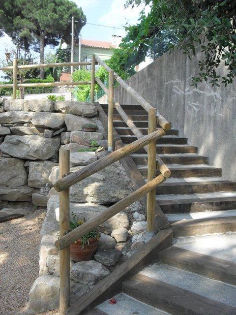 Jardineria flor de neu for Jardines con madera y piedra